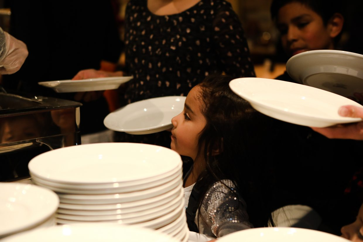 Kids wait in line for the holiday meal for the Bright Futures holiday party on Tuesday, Dec. 19, in Vail. The meal featured turkey, stuffing, mashed potatoes, sweet potatoes, green bean casserole and pie.