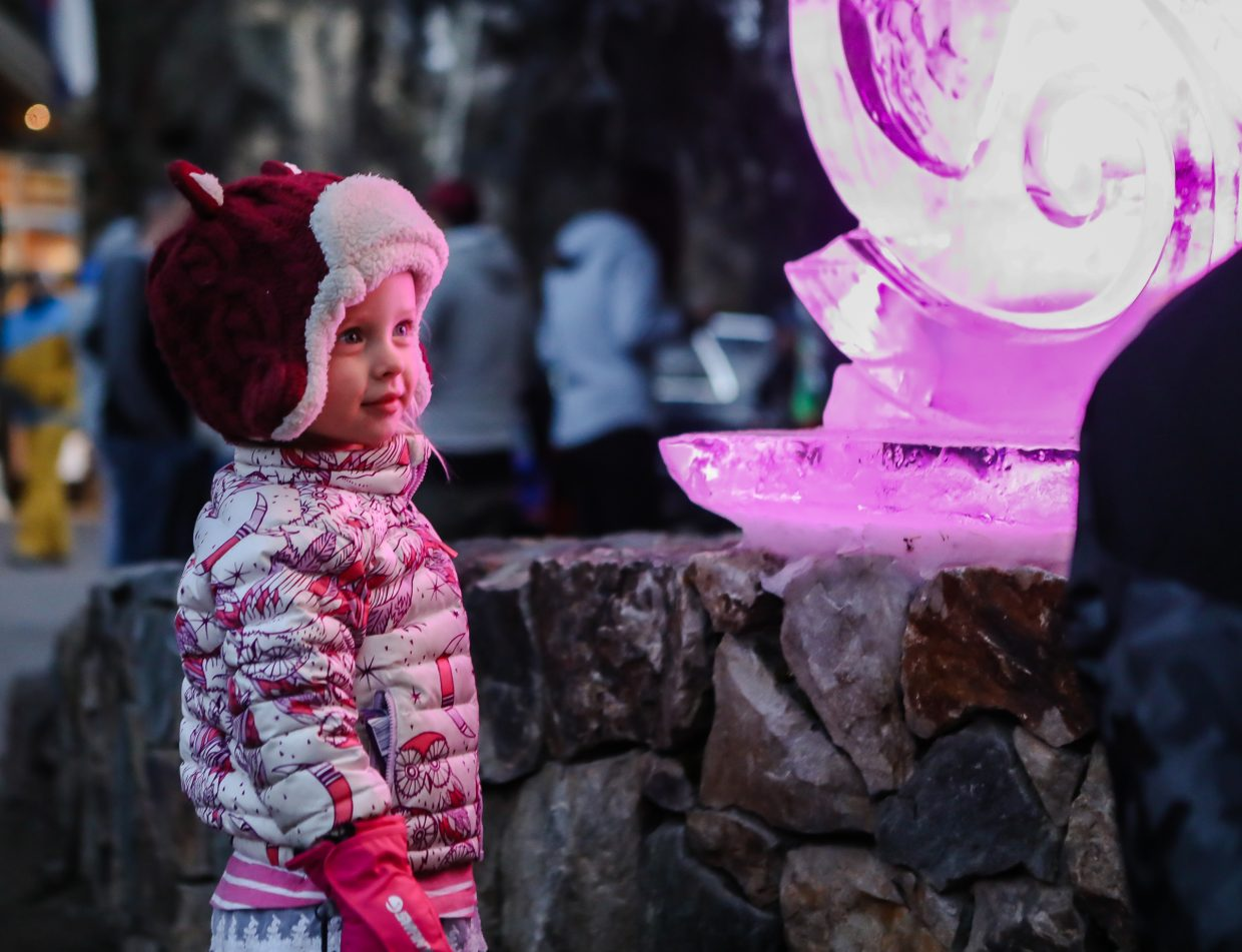 Amarra Swanson, 2, of Vail admires the lighted ice sculpture during the annual Holiday Tree Lighting on Sunday, Dec. 17, in Vail. The annual event featured St. Nick, live music and lots of lights.