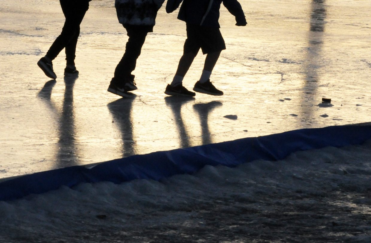 Eagle Ice Rink 2 KA 1-17-18 Kristin Anderson Kids play on the smaller ice rink Wednesday at Eagle Town Park.