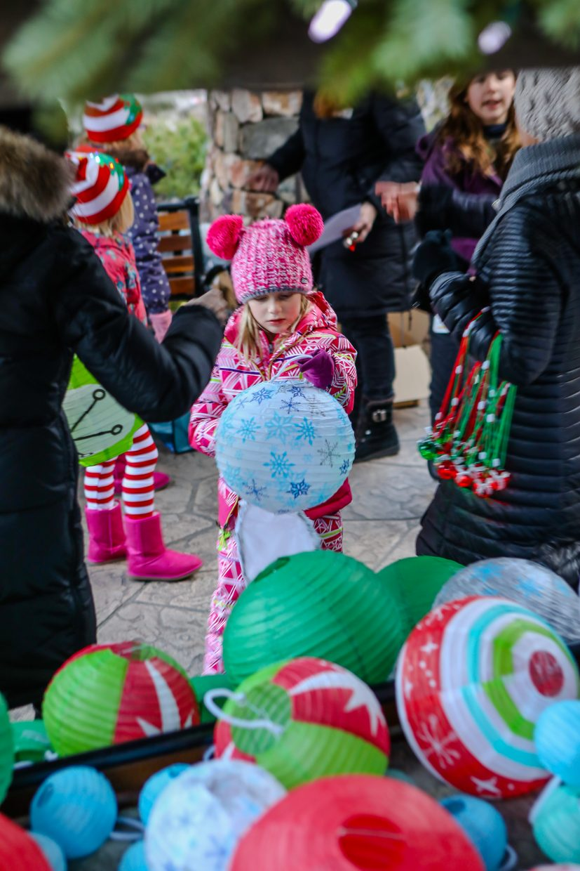Hattie St. John, 6, of East Vail gets her lantern for the Holiday Lantern Walk on Friday, Dec. 22, in Vail.