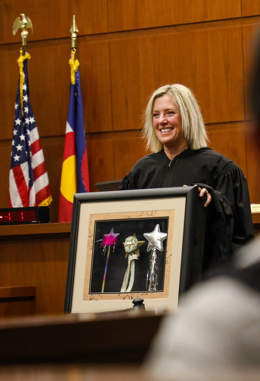 Judge Katherine Sullivan is gifted her wands she would use to pass people along to different stages of Drug and DUI Court during her farewell on Wednesday, Dec. 20, in Eagle. She graduated seven people from drug and DUI court.