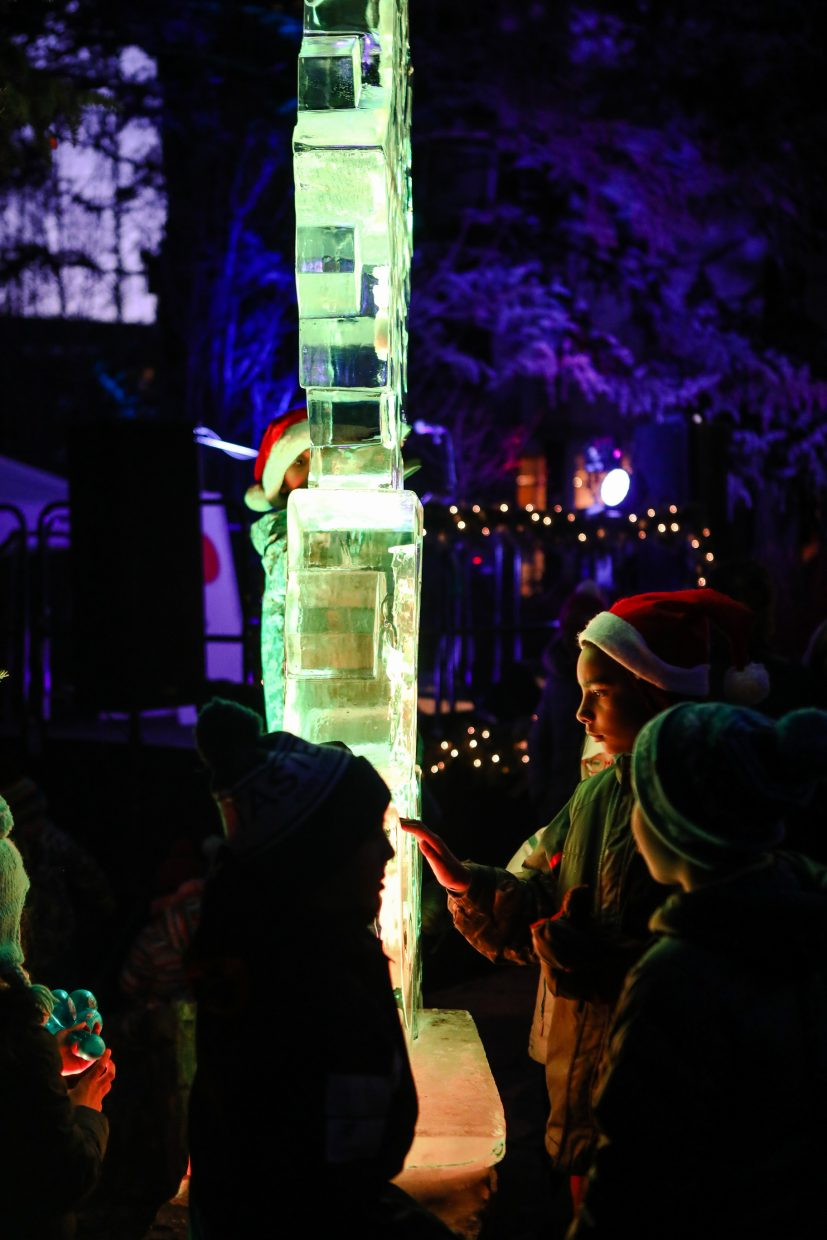 Kids check out the lighted ice sculpture for the annual Holiday Tree Light on Sunday, Dec. 17, in Vail. The town has more than 50 miles of lights, three miles of garland and 400 hundred wreaths around town.