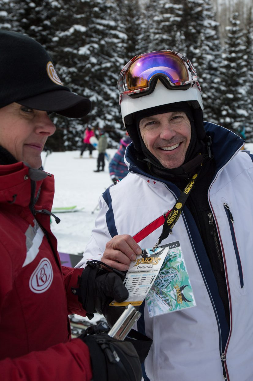 Rich Liberante from Scottsdale Arizona gets his credentials punched after finishing the Talons Challenge, skiing 14 black and double black runs at Beaver Creek, Saturday.