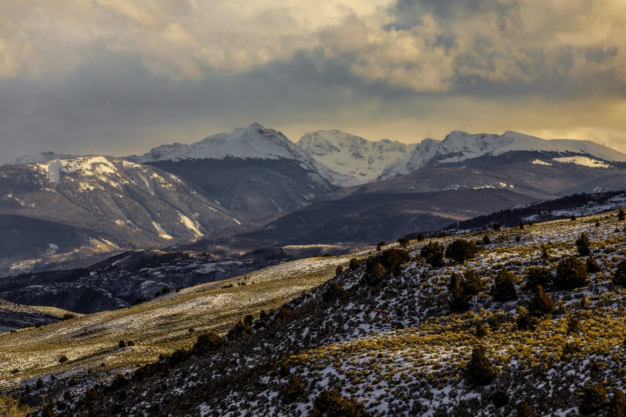 Sunlight peaks through the clouds over New York Mountain and the Sawatch Range on Thursday, Feb. 22, near Bond. A series of storms are forecasted through this weekend, with the potential to drop up to a foot and a half by the end of the weekend.