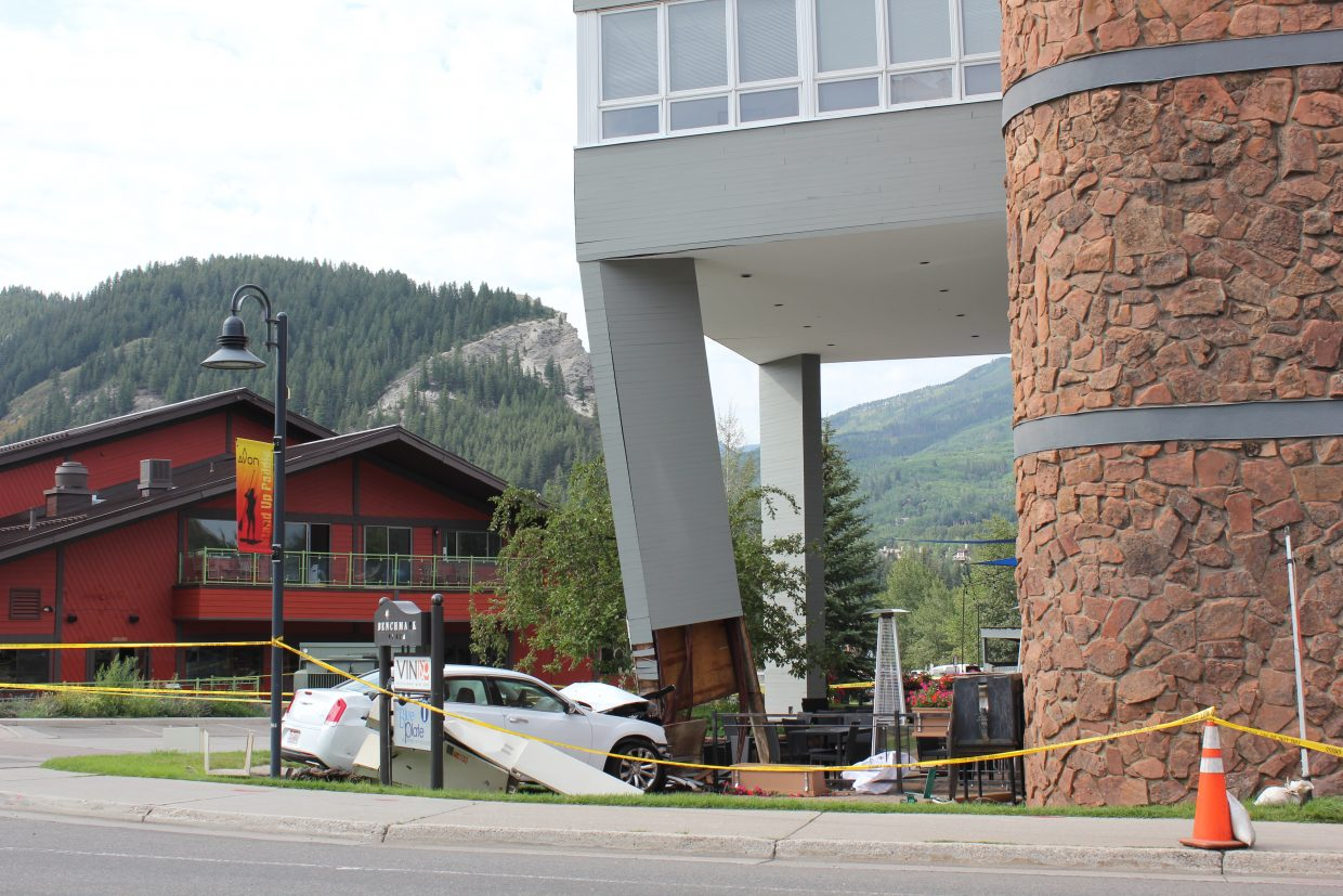 This Chrysler 300 rental car rolled over a road sign and into Avon's Benchmark Plaza building, damaging a structural column that helps support the second and third floors. The building has been evacuated. The accident happened around 8 a.m. Friday. No alcohol is thought to be involved, authorities said.