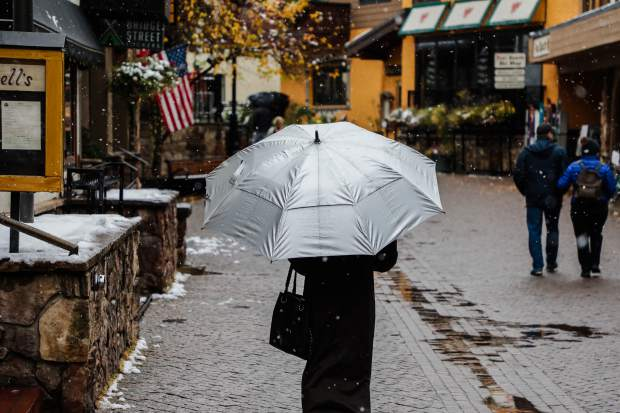 Snow falls in the village Thursday, Oct. 11, in Vail. The system has brought the first measurable snow to the valley floor.