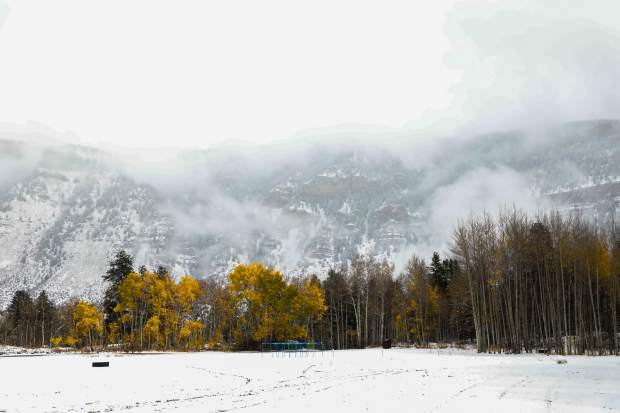 Clouds shroud the mountains as snow comes down Thursday, Oct. 11, in Maloit Park in Minturn. A more stable pattern is forecasted through the second half of October.