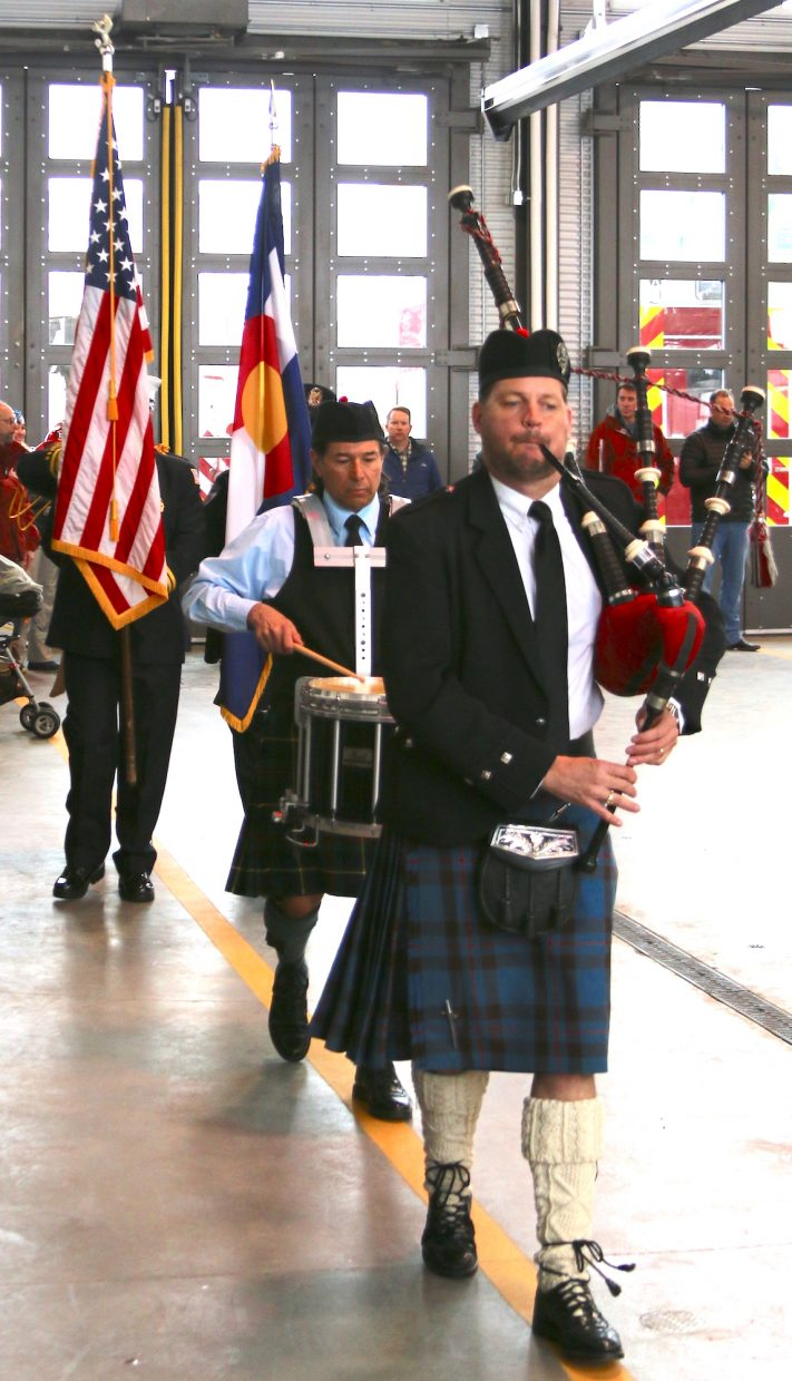 A bagpipe and drum duo led the procession into Station 12 for the dedication.