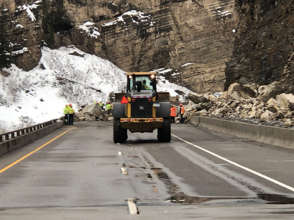 Crews work to remove rocks on I-70 on Monday in Glenwood Canyon.