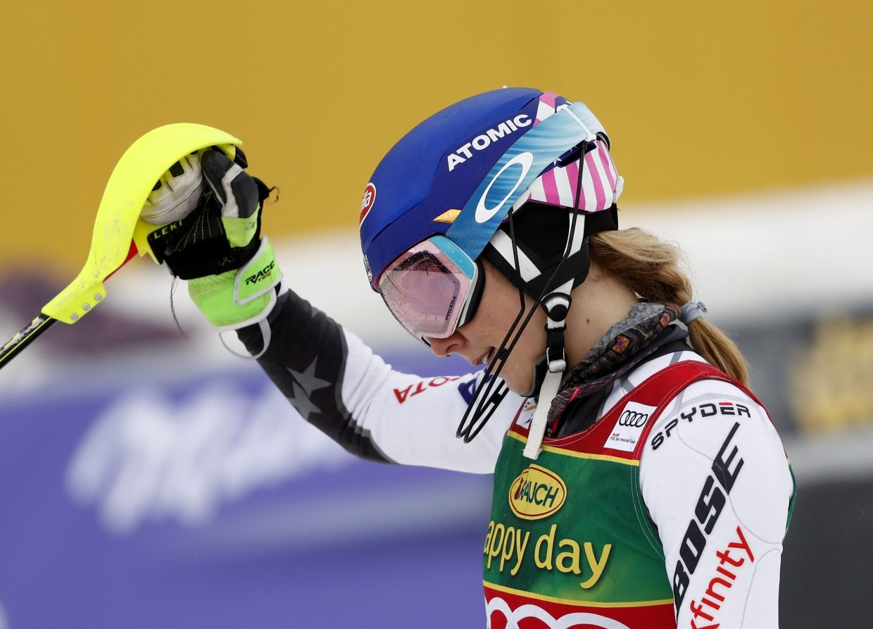 Mikaela Shiffrin celebrates Saturday's World Cup slalom win in Maribor, Slovenia. This is her 13th World Cup win this season, a new record for an American.