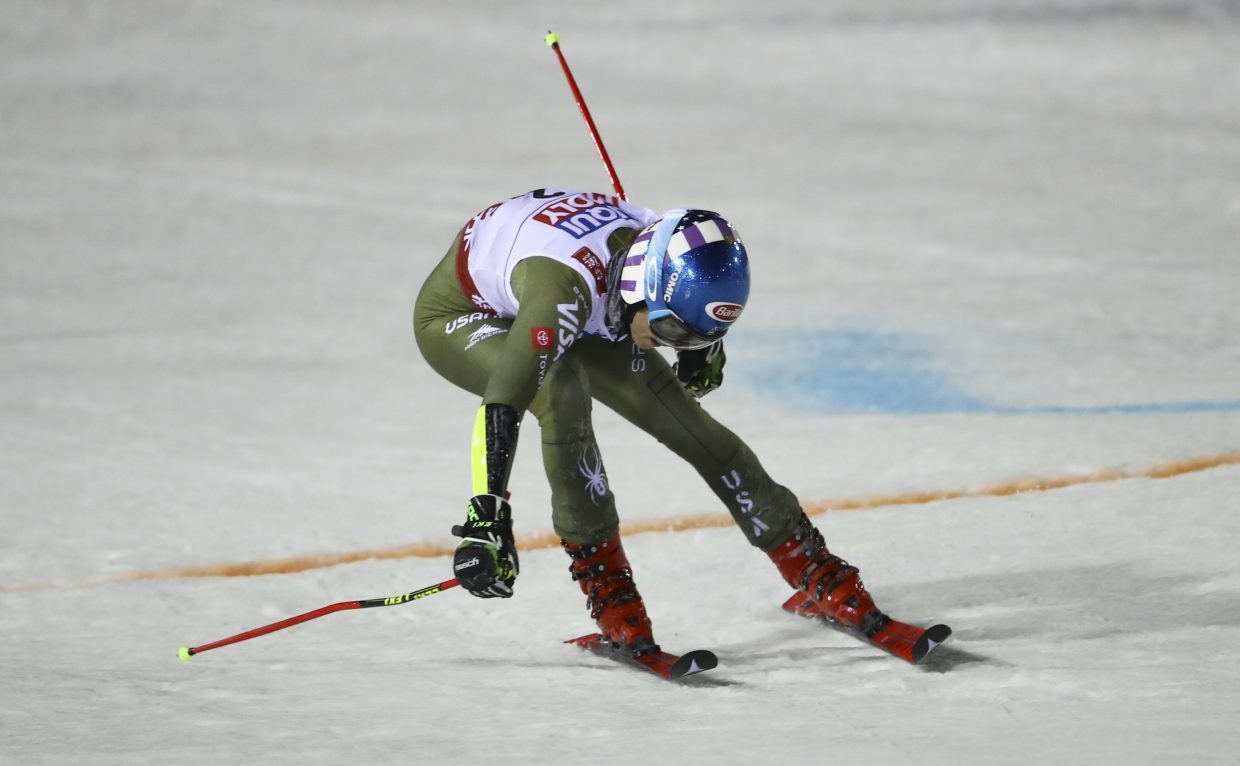 Mikaela Shiffrin reaches across the finish line in Are, Sweden, during Thursday's FIS Alpine World Ski Championships. Shiffrin finished 38-hundredths of second behind winner Petra Vlhova.
