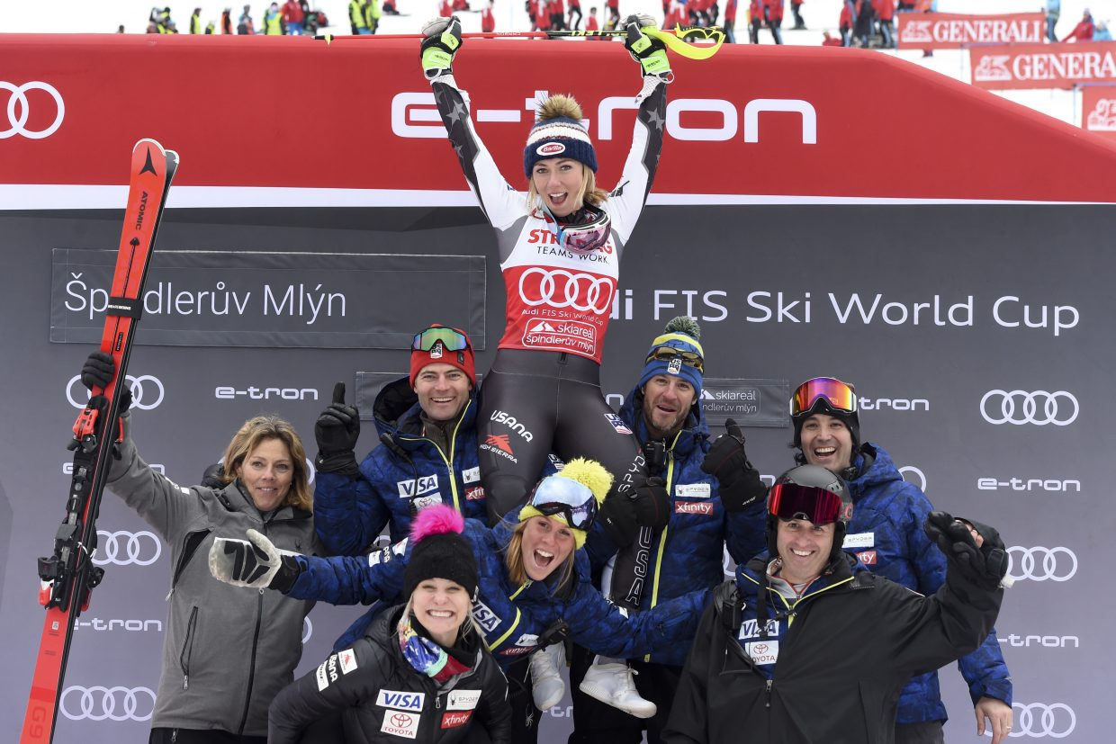 Mikaela Shiffrin celebrates with her team after her win on Saturday. After the race, Shiffrin said that her new schedule has helped her stay fresh during the long World Cup season.