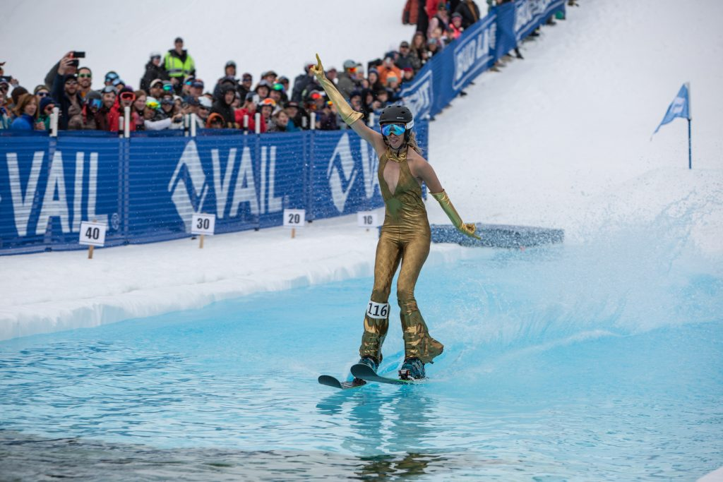 Langely McNeal from Idaho disco dances across the pond in the pondskimming championships at Golden Peak, Sunday. McNeal took first place in the women's competition.