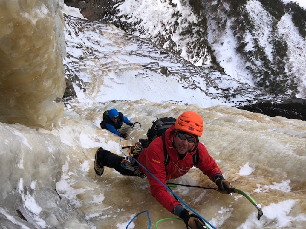 Eric Alexander, in red, has been climbing with Erik Weihenmayer for years. Among their other summits, the duo climbed Mt. Everest, making Weihenmayer the first blind climber to do it.
