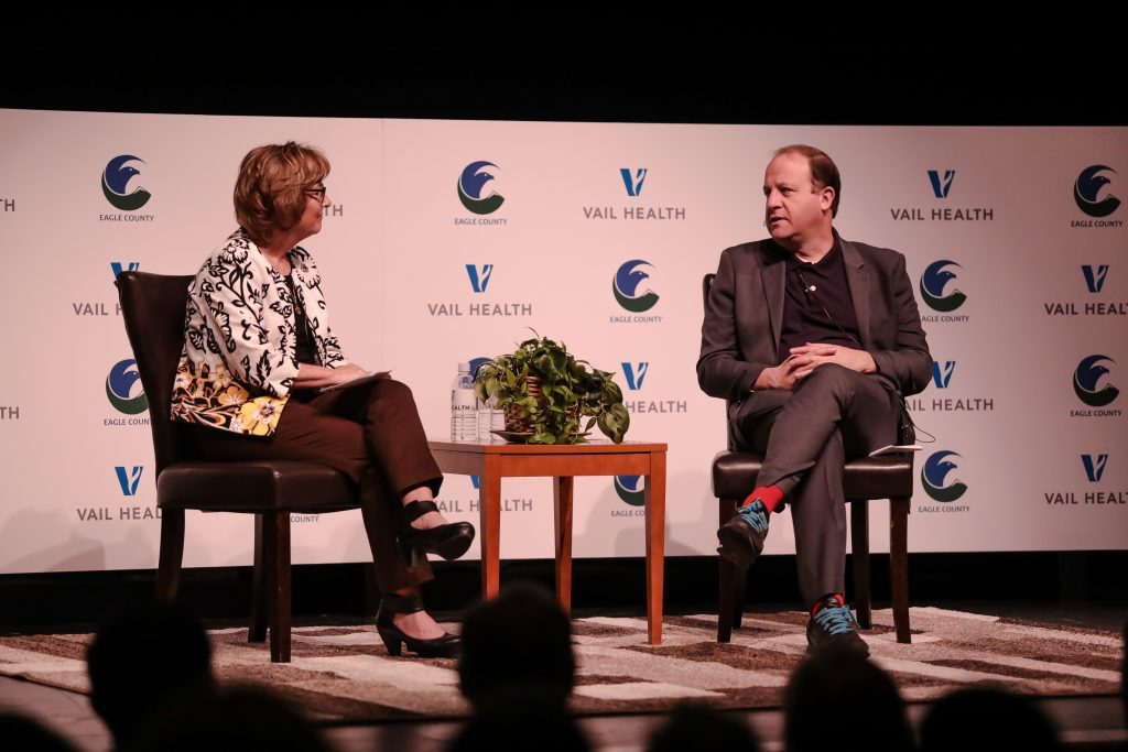 Colorado Gov. Jared Polis speaks with Eagle County Commissioner Chair Jeanne McQueeney during a discussion on mental health Friday at Battle Mountain High School in Edwards. A suicide is attempted every day in Eagle County.
