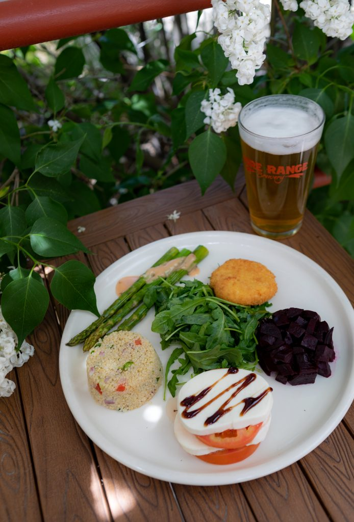 Seasonal Salad | asparagus with mustard sauce, tomato caprese, quinoa salad, roasted beets, arugula with fried goat cheese from the Gore Range Brewery in Edwards.