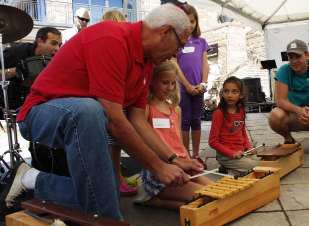 Local musician Tony Gulizia teaches kids about instruments and jazz music during Jammin' Jazz Kids.