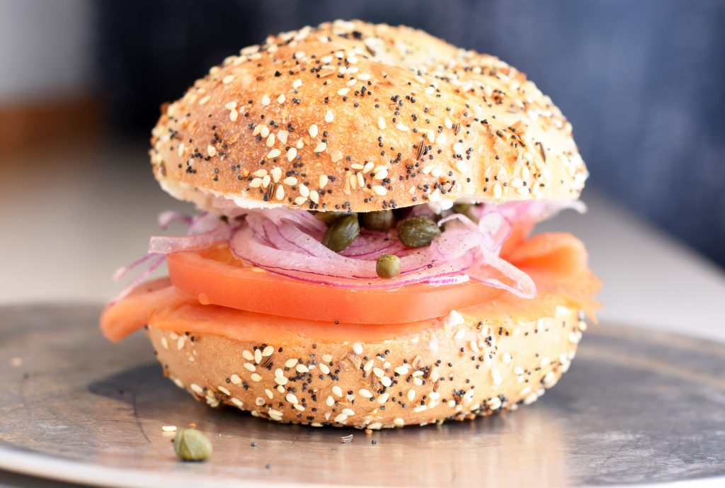 Kristin Anderson Village Bagel's NYC Upgrade bagel with cold smoked salmon, caper, red onion, tomato and scallion shmear.