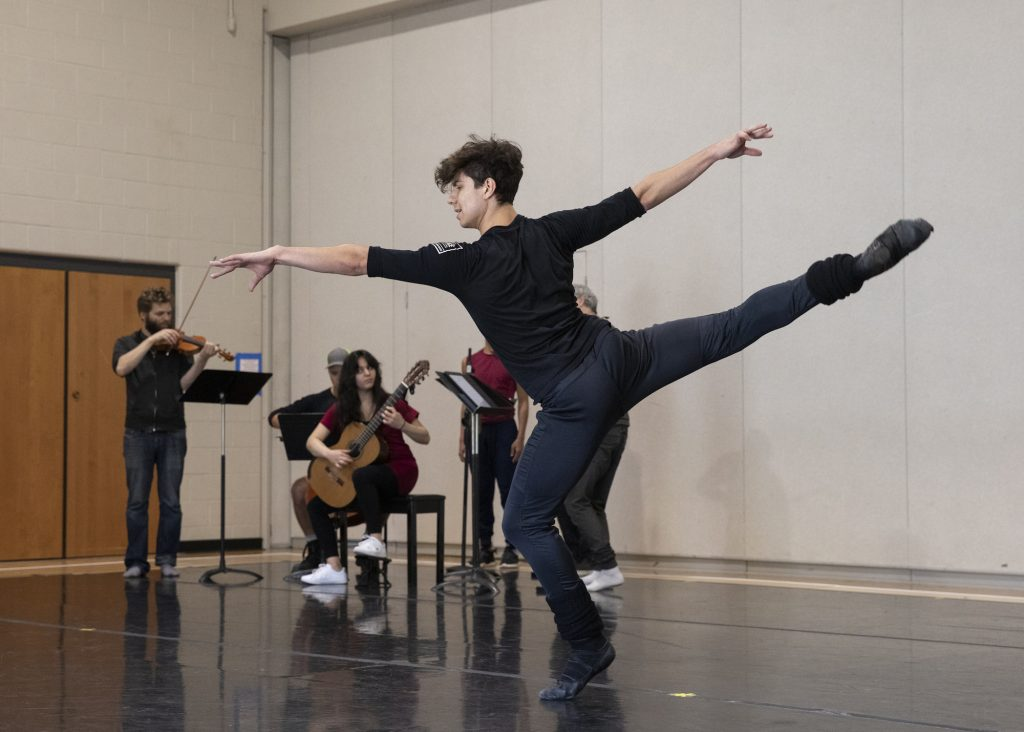 """Roman Mejia from the New York City Ballet rehearses his solo in """"Fandango"""" at the Vail Mountain School on July 30 with string quartet Brooklyn Rider and guitarist Alberta Khoury in a new collaboration with choreographer Alexi Ratmansky."""