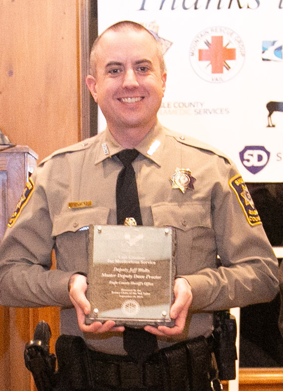Unit Citation Meritorious Service Master Deputy David Proctor and, pictured, Deputy Jeff Waltz of the Eagle County Sheriff's Office. On the morning of July 2, 2019, Proctor and Waltz received a report of a suicidal girl, who was walking to a store to buy enough Tylenol to kill herself. Proctor spotted her on Gypsum's I-70 overpass bridge, with her feet dangling over the side. She looked like she was preparing to jump onto the eastbound lanes and into traffic below. Proctor tried to talk to her, but she did not respond. When Waltz arrived, he saw what was happening. As Proctor continued to talk to her, Waltz walked behind the girl and wrapped his arms around her, pulling her off the bridge to safety.