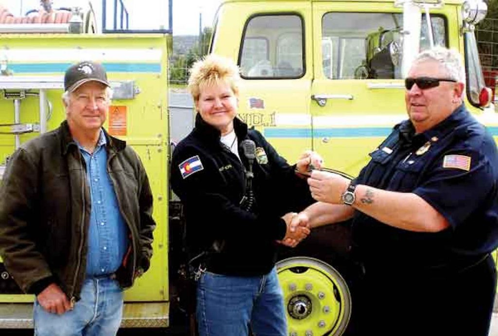 Jon Asper handed over the keys to one of the Eagle fire department's trucks to the Rock Creek fire department in northwest Eagle County.