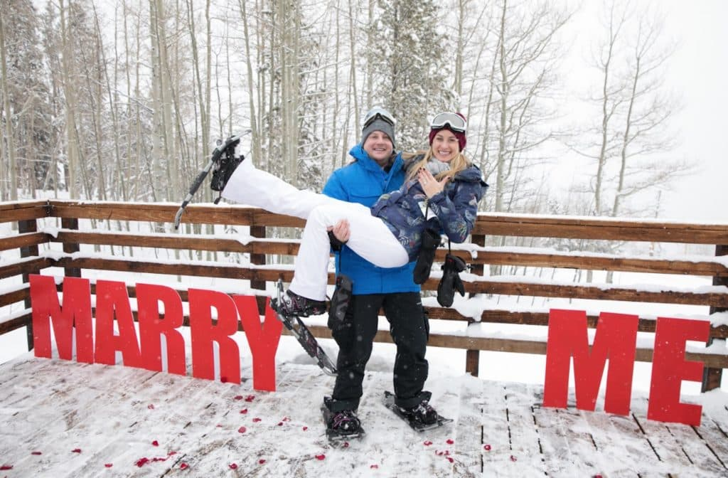 A snowshoe tour at Beaver Creek set the stage for Ryan's proposal to Kali. Kali loves to play guitar so Fleck arranged to have a guitarist on a deck near Strawberry Park lift in Beaver Creek playing her favorite song while the couple snow shoed up to the steps of the deck. The Balloon Bar custom-made the letters for the occasion.