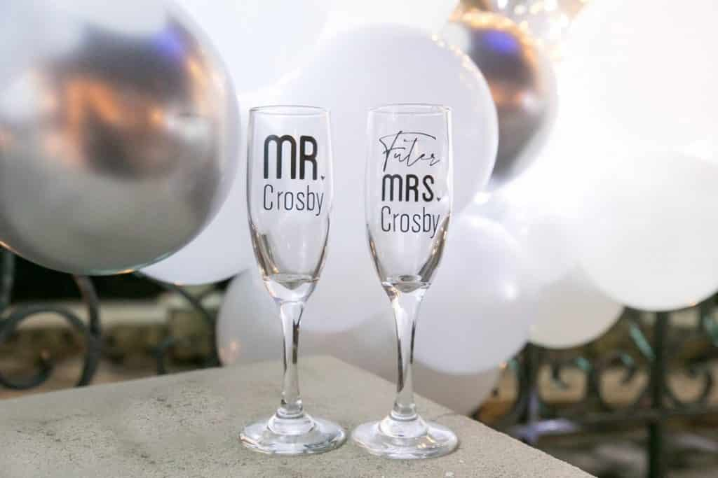 """Fleck says """"more is more"""" and handles all the details, including these personalized champagne glasses for the couple to use during the proposal."""